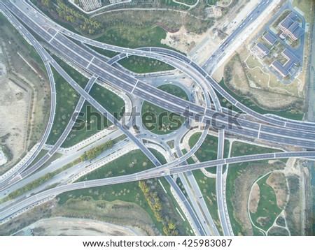 aerial view of busy traffic on road junction - stock photo