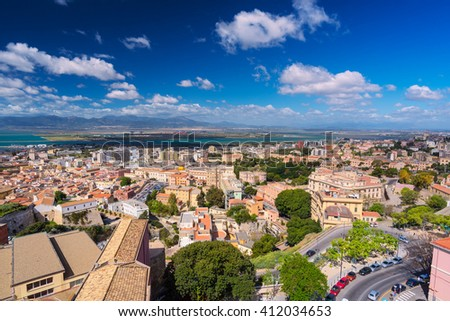 Aerial view of Cagliari city with commercial port in distance - stock photo