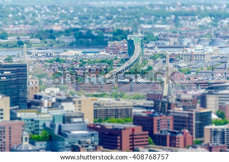 Aerial View of Central Boston and the Tobin bridge, USA. Tilt-shift effect applied - stock photo