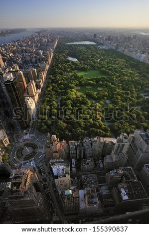 Aerial view of Central Park and Columbus Circle, Manhattan, New York; Park is surrounded by skyscraper  - stock photo