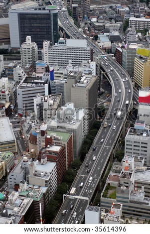 Aerial view of central Tokyo highways, skyscrapers, apartment buildings and shops - stock photo