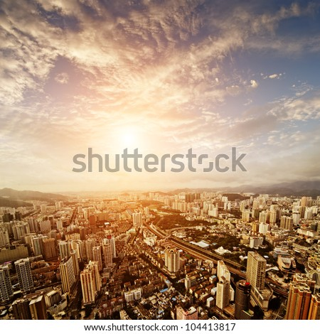 Aerial view of  chinese city at sunset - stock photo