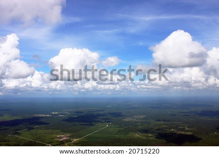Aerial view of cloudspace over greeny land. - stock photo