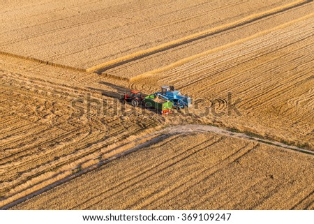 aerial view of combine on the harvest field in Poland - stock photo