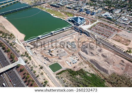 Aerial view of construction on a dam in the Arizona desert - stock photo