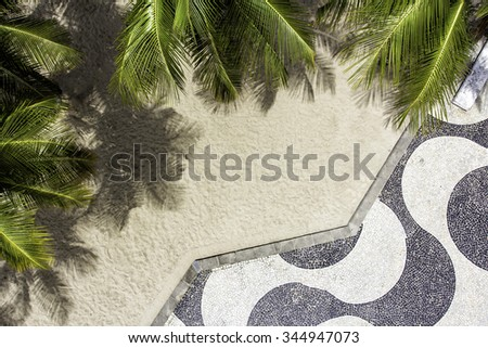 Aerial view of Copacabana Beach sidewalk mosaic with palms. Top view - stock photo