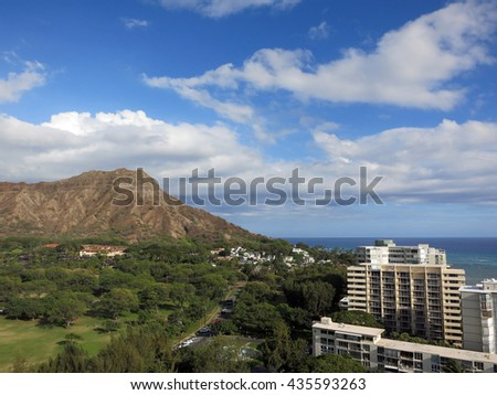 Aerial view of Diamondhead, Kapiolani Park, the gold coast, Pacific ocean, and waves on Oahu, Hawaii.  March 2016. - stock photo