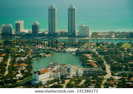 Aerial view of diverse apartment building and skyscrapers in Miami city with waterfront in background, Florida, U.S.A. - stock photo