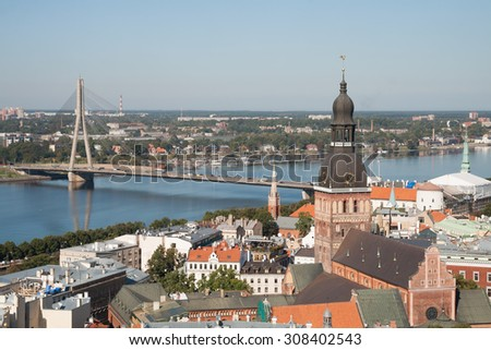 Aerial view of Dome Cathedral and bridge across the Daugava River, Riga, Latvia - stock photo