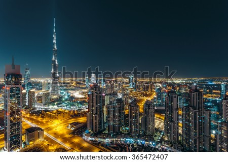 Aerial view of Dubai's business bay architecture by night. - stock photo