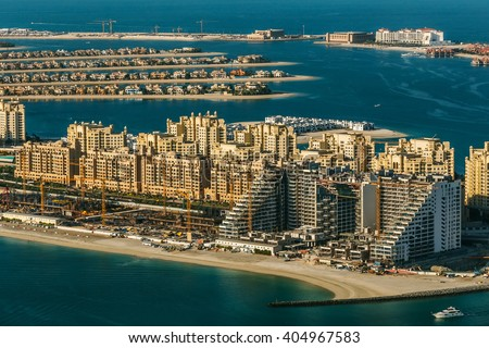 Aerial view of Dubai's Palm with hotels and residential houses. UAE travel and construction concept.  - stock photo