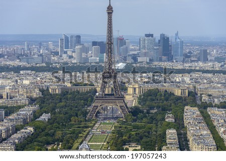 Aerial view of Eiffel Tower and La Defense business district taken from Montparnasse Tower in Paris, France - stock photo