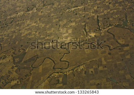 Aerial view of Ethiopian farmland and river - stock photo