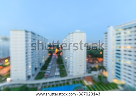 Aerial view of Eunos neighborhood in Singapore at blue hour. The new estate HDB housing complex with outdoor tennis and basketball court, car park, and green garden at the center. Urban concept - stock photo