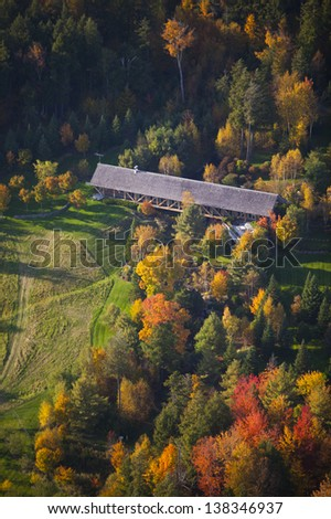 Aerial view of fall foliage and a covered bridge, Stowe, Vermont, USA - stock photo