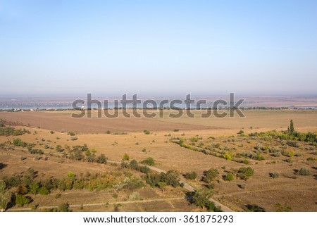 Aerial view of fields and river - stock photo