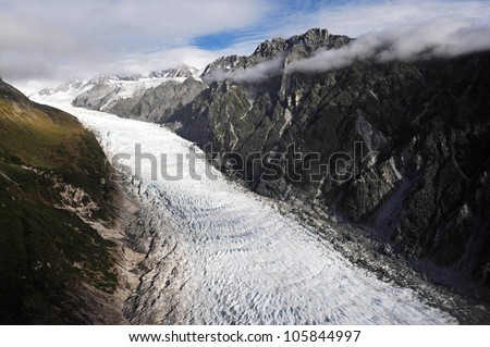 Aerial view of Fox Glacier on the west coast of New Zealand. - stock photo