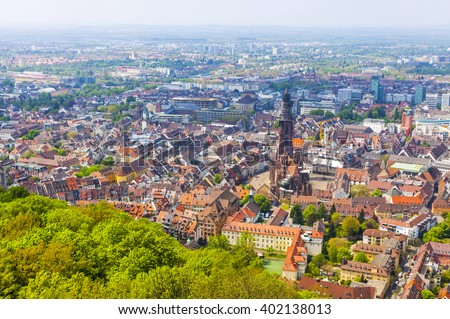Aerial view of Freiburg im Breisgau city, Germany. Freiburg Munster and old town can be seen in the center of picture - stock photo