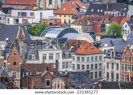 Aerial view of Ghent from Belfry - roofs and beautiful medieval buildings. Ghent is a city and a municipality located in the Flemish region of Belgium. - stock photo