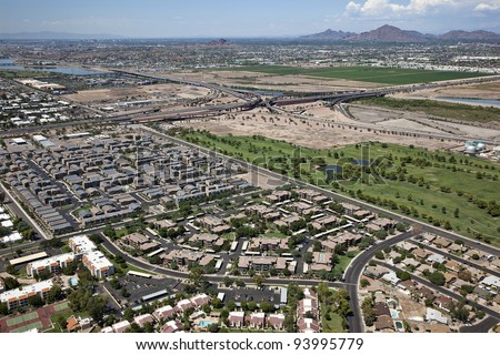 Aerial view of golf course and rooftops along Loop 202, Red Mountain Freeway - stock photo