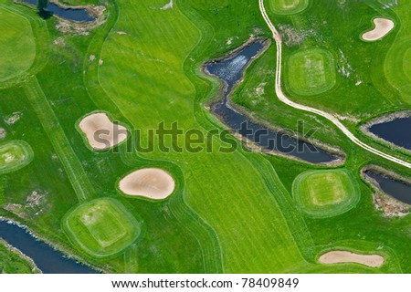 Aerial view of golf course and water - stock photo