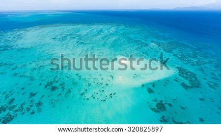 Aerial view of Great Barrier Reef with coral sand cay beach, Queensland, Australia - stock photo