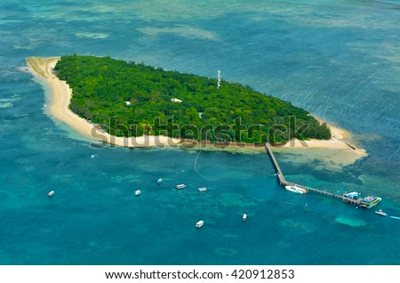 Aerial view of Green Island reef at the Great Barrier Reef near Cairns in Tropical North Queensland, Queensland, Australia. - stock photo