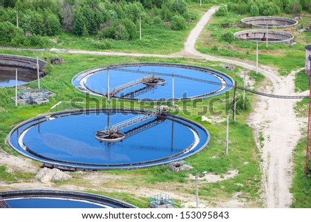 Aerial view of group of primary circular sedimentation tanks for sewage cleaning - stock photo