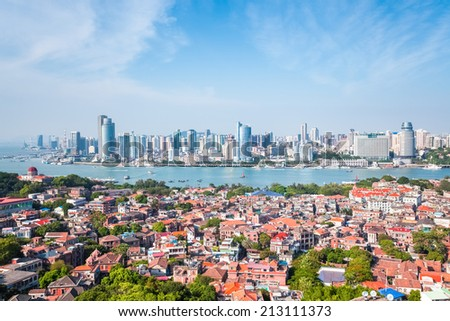 aerial view of gulangyu island with xiamen skyline in daytime  - stock photo
