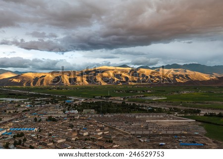 Aerial view of Gyantse county from top of Zongshan fort, Tibet, China - stock photo