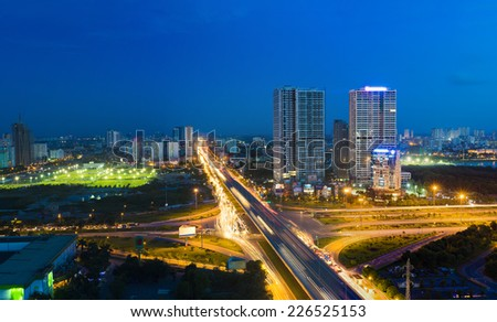 Aerial view of Hanoi cityscape at twilight in Le Van Luong street - stock photo