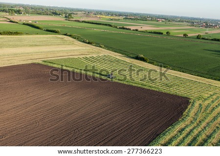 aerial view of harvest fields with combine in Poland - stock photo