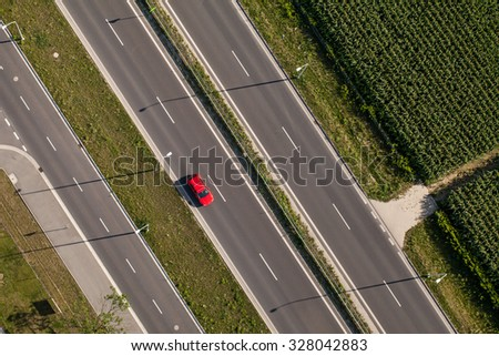 aerial view of highway in Summer time with green fields - stock photo
