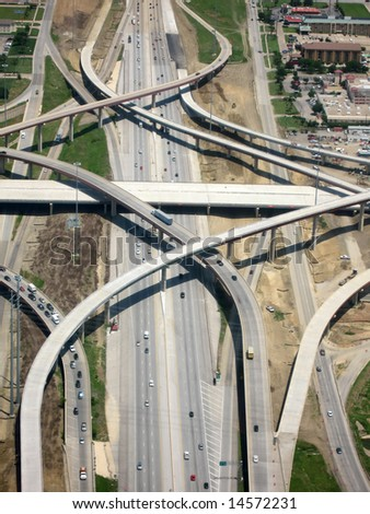 Aerial View of Highway with Crossing Lanes - stock photo