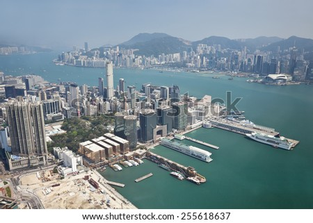 Aerial view of Hong Kong with Kowloon Peninsula in the foreground - stock photo
