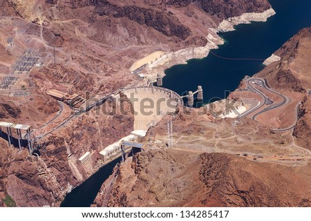 Aerial view of Hoover Dam and the Colorado River Bridge during construction - stock photo