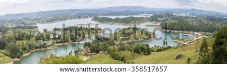 Aerial view of hotel near the lakes and islands in Guatape taken from Piedra el Penol with blue sky, near Medellin, Colombia. - stock photo