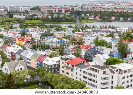 Aerial view of houses and pond in Reykjavik, Iceland - stock photo