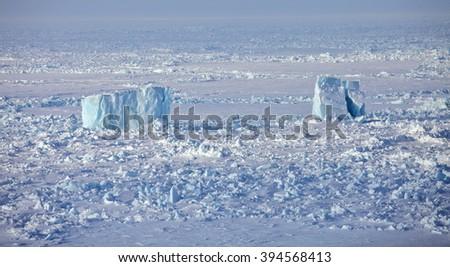 Aerial view of iceberg in frozen Arctic Ocean  - stock photo