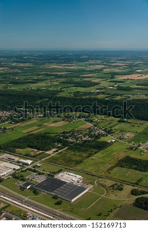 Aerial view of industry and agriculture - stock photo
