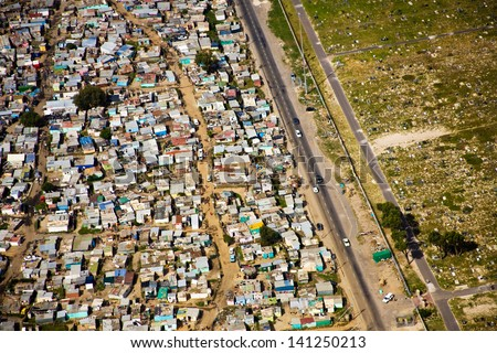 Aerial view of informal settlements of the Cape Flats with bordering graveyard, Cape Town, South Africa - stock photo