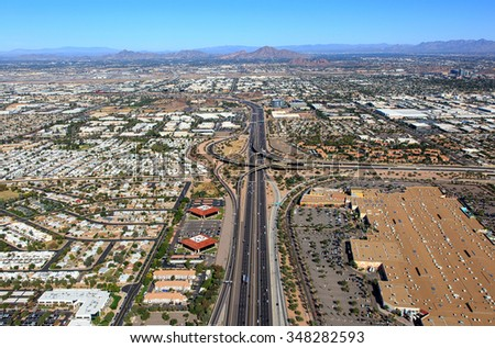Aerial view of Interstate 10 and U.S. Route 60 (Superstition Freeway) interchange looking north along the border of Tempe and Phoenix, Arizona - stock photo