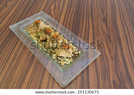 Aerial view of Japanese cuisine of baked salmon baked salmon maki sushi topped with processed seaweed, roasted same seed and salmon roe. - stock photo