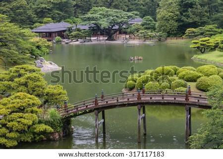 aerial view of Japanese garden in rain - stock photo