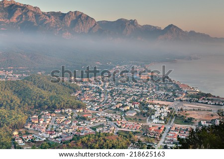 Aerial view of Kemer town, Mediterranean resort, Antalya province, Turkey, in the morning, at dawn, when the fog. - stock photo