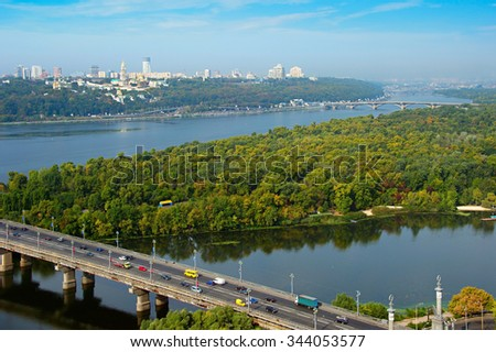 Aerial view of Kiev with Dnipro river and Kiev Pechersk Lavra on the top of the hill. Ukraine - stock photo