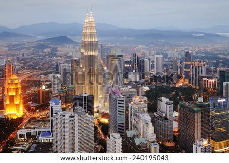 Aerial view of Kuala Lumpur at nightfall - stock photo