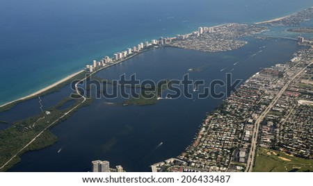 Aerial view of Lake Worth and Riviera Beach with Singer Island along the Atlantic Ocean - stock photo