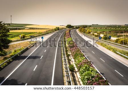 Aerial view of lanes highway in Spain - stock photo