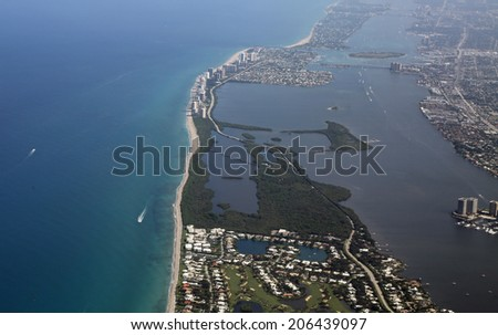 Aerial view of Lost Tree Village and John D MacArthur State Park in North Palm Beach, Florida - stock photo